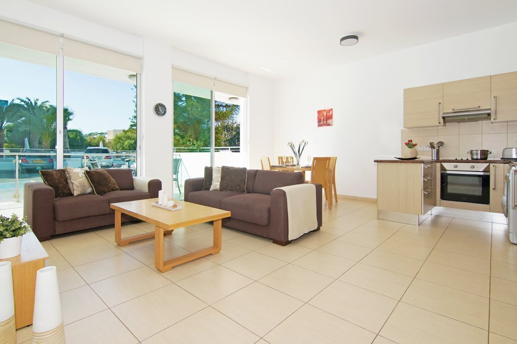 sitting room and kitchen protaras 2 bed